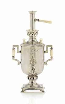 A PARCEL-GILT TABLE LIGHTER IN THE FORM OF A MINIATURE SAMOVAR BY FABERGÉ, WORKMASTER ANDERS (ANTTI) NEVALAINEN, ST PETERSBURG, 1899-1904. Realistically modelled, on four scroll feet, the square base rising to a cylindrical body, with upright angular handles applied with ivory, with ivory knobs, the teapot base enclosing a well for lighter fluid, the front engraved with initials and date 'R.J.R.H. / 1902.', the back engraved with initials 'C.E.R.'