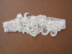 Wedding garter- Lace bridal Garter Set, Vintage Style Wedding garter, Ivory Bridal Garter, Embroidery floral lace garter, Bridal shower gift. $32.00, via Etsy.