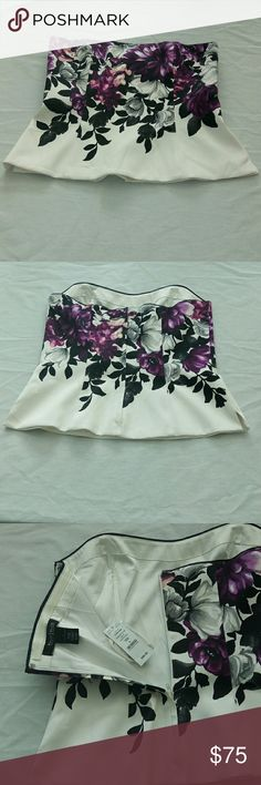 """White House /Black Market Floral Print Bustier New with tags White House/ Black Market floral print bustier. Size 6, comes with straps. Zipper on the back.bust:32"""" length: 30"""" waist: 30. Has a split cut on the side. White House Black Market Tops Crop Tops"""