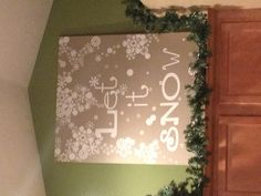 Any size canvas board, decals, spray paint, set of Christmas lights. Put the decals on the canvas and spray paint-then remove decals. Add lights behind the board and the letters glow!