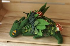 Felted dragons by Alena Bobrova - green dragon with mushrooms