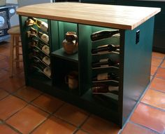 Rustic kitchen in Hartford Mist Dark Green. A perfect blend of traditional style and modern comforts. Featuring a custom wine rack with LED lighting, cookbook shelf and refinished butcher block. IMDesign cabinetry is very versatile, this kitchen has the best of both worlds! Elegant. Modern. Smart. Durable