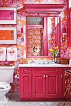 Designing for someone who likes bright colors? This bathroom would be perfect for them! If it's a bit much, use less color, such as on the molding around the lights, the mirror frame, and the edges of the cabinet doors!