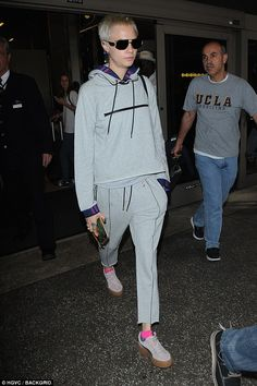 Cara Delevingne proved that comfort needn't mean sacrificing style as she headed through London's Heathrow Airport in a tracksuit that exuded high-fashion on Saturday.