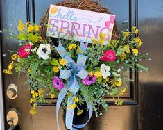 Decorate your front door for spring with a full and beautiful Hello Spring wreath. Full of bright colors and premium flowers and greenery, this wreath will show perfectly from your front door to the road. The bow and the sweet welcoming sign add the finishing touches for this spring decor! Spring Sign, Spring Door, Outdoor Wreaths, Outdoor Christmas Decorations, Mothers Day Wreath, Peonies Garden, Mini Roses, Wedding Wreaths, Summer Wreath