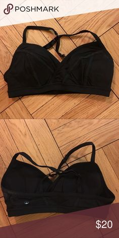 Lululemon sports bra Black lululemon sports bra with adjustable cross straps and removable cups. Good condition. Tag has been removed. lululemon athletica Intimates & Sleepwear Bras