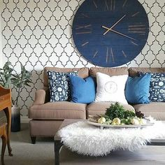 A navy blue and white stenciled living room accent wall using the Marrakech Trellis Allover Stencil from Cutting Edge Stencils and an oversized wall clock. http://www.cuttingedgestencils.com/moroccan-stencil-marrakech.html