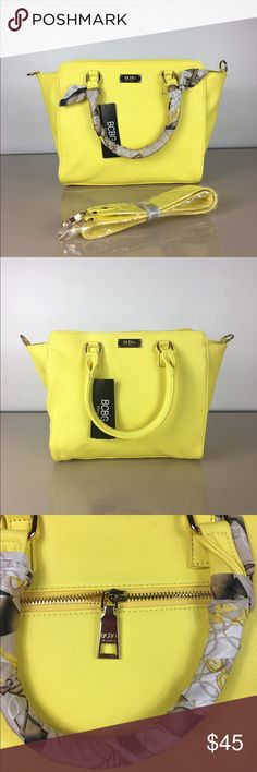BCBG Paris Scarf Story Satchel Handbag Update your style with this delicately designed satchel handbag. Made of durable faux leather The bag features a zipper.  Available in various fashionable colors, including beige, black, red, grey, blue, orange, purple and yellow Made of durable faux leather Double handle handbag Features a zipper closure for maximum safety BCBG Bags Satchels