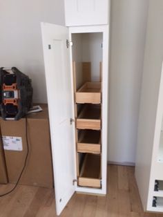 Ikea: Tall Pantry Cabinet with pull-out shelves, so you can reach ...