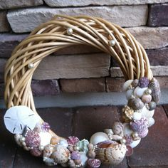 My summer wreath...shells from the last time we went to the beach, a wreath form from Goodwill for .99 and some pearls from my bead stash!