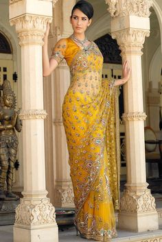 Yellow Net Saree with Kundan & Antique work