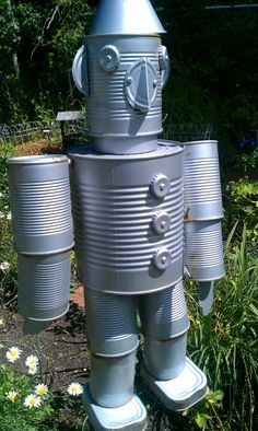 Upcycled Tin Can Man Windchime Recycled Garden Art, Garden Crafts, Recycled Crafts, Garden Projects, Recycled Materials, Tin Can Man, Tin Man, Soda Can Crafts, Fun Crafts