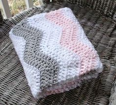 A simple pink and gray crochet chevron baby blanket for your baby girl. Perfect crib bedding for a gray and pink chevron nursery! Your tiny princess will be warm and cozy in this crochet blanket.   { HANDMADE } This blanket will be handmade by me. Current crochet time for blankets is 4 weeks.   { MATERIALS } Crocheted with pink, gray and white acrylic yarn.   { MEASUREMENTS } The blanket measures 27 x 28 inches. Please measure to make sure of the size you need.   { CARE INSTRUCTIONS }…