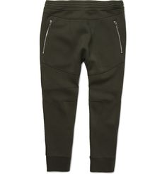 <a href='http://www.mrporter.com/mens/Designers/Neil_Barrett'>Neil Barrett</a>'s 'Motorcycle' sweatpants typify the designer's fusion of sportswear and tailoring. This colour-block pair is crafted from panels of army-green, midnight-blue and white bonded-jersey, artfully arranged to create a geometric quilt effect. The zipped pockets further the biker-inspired feel. Team with the [matching hoodie id634615] and sporty kicks.