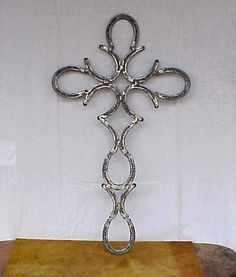 Hand Forged Horseshoe Fancy Cross - I like this one much better than the one you usually see