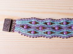 Hand Beaded bracelet blue purple beads with by SparklenLight