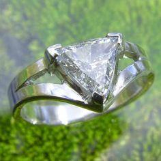 Trillion Cut Diamond Ring. I I love this type of settings.