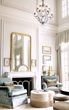 Beautiful tall cieling chandelier home inspiration white walls mirror over fireplace