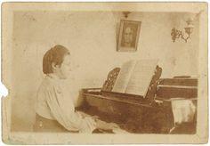 A 15-year-old Marina Tsvetaeva by her piano in 1908.