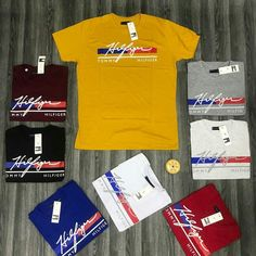No photo description available. Cali Colombia, Tommy Hilfiger Outfit, Cool Shirts For Men, Converse Logo, Le Polo, Polo T Shirts, Branded T Shirts, Mens Tees, Shirt Designs