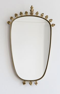 laboratory22:  1950′s, Italy Vintage brass mirror with leave decoration.
