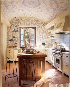 PASTEL KITCHEN Swirling lavender designs make this kitchen, designed by Erin Martin, romantic and a touch theatrical. Click through for more spring decorating ideas.