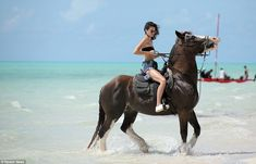 Eau de Kendall: Looking like a scene from a movie - or perhaps a perfume advert - there was no mistaking Kendall Jenner for a beginner as she confidently took the reigns of her steed while on a ride in Turks and Caicos