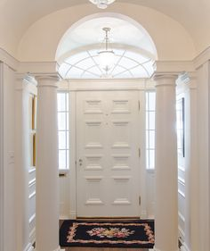 Branch House front door ~ The columned vestibule and barrel vaulted entry hall welcomes you into Colonial Revival-style home designed by Neel Reid, who was one of the best residential architects in Atlanta.