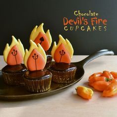 Chocolate and habanero cupcakes are enrobed in chocolate ganache and decorated with candy flames. The surprising flavor is…devilishly magical!