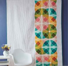 Modern bed quilt pattern download made with a modified Nine-patch block with curved piecing designed by Nichole Ramirez.