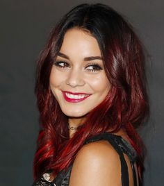 Vanessa Hudgens ditches her blonde ombre look for dark red strands and a tousled lob.