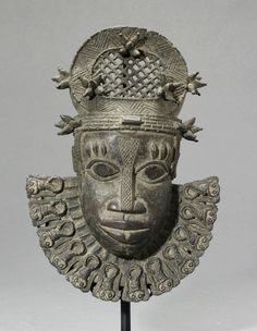"Benin Bronze Hip Mask - DB.016 (LSO) Origin: Nigeria Circa: 18 th Century AD to 19 th Century AD Dimensions: 8.4"" (21.3cm) high x 6"" (15.2cm) wide Collection: African Art Medium: Bronze Condition: Extra Fine"