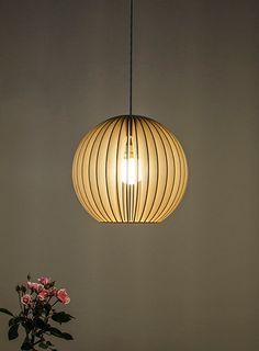 Aion  - wooden hanging lamp. €119.00, via Etsy.