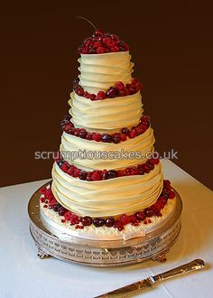 www.scrumptiouscakes.co.uk (690) - 4 tier white chocolate wrap wedding cake with fresh red berries.