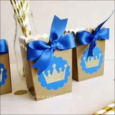 Handmade Royal Prince theme popcorn favor boxes sparkle with a gold glitter crown for his baby shower or birthday party! Use at dessert tables or to fill with t