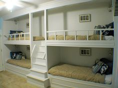 Built-in Bunk Beds for the basement... could alter it a bit for a different take on home theater seating without taking up so much space