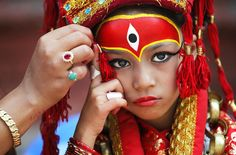 A Nepalese mother applies makeup to her daughter at Hanuman Dhoka temple in Kathmandu, Nepal. Girls under the age of 9 gathered for the Kumari Puja, a tradition of worshiping young prepubescent girls as manifestations of the divine female energy. The ritual holds a strong religious significance in the Newar community that seeks divine blessings to save small girls from disease and misfortune in the years to come. Niranjan Shrestha / AP