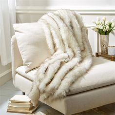 Artic White Lynx Faux Fur Throw design by Tozai ($112) ❤ liked on Polyvore featuring home, bed & bath, bedding, blankets, throws & blankets, faux fur bedding, tozai, white throw blanket, white bed linens and white bedding