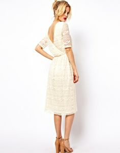 ASOS Midi Dress In Lace With Wrap Back, $63.18. You guy it as a wedding dress, I'll just BUY it.