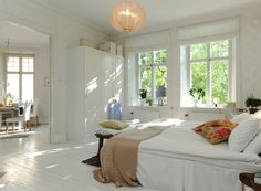I love how this room has great windows and double doors that open up to create an even larger airy space.