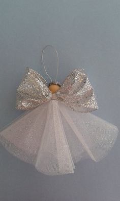 Gorgeous sparkling angel ornament, shes 5 tall and made with silver glittery ribbon and tulle. Angel ornament by bundlesandmore on Etsy Christmas Angel Ornaments, Christmas Tree Decorations, Diy Angel Decorations, Christmas Poinsettia, Diy Angels, 242, Theme Noel, Christmas Crafts, Crochet Christmas
