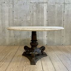A table base masterfully created in the manner of a 19th century antique French cast iron street lamp post paired with a 50″ round vintage cast limestone top. Impressive cast base has three detailed lion paw feet in a posing fashion with bent knees. Iron base and stone surface are suitable for indoor or outdoor use. Minor chips in table top but in overall good condition consistent with age and use.  Measurements: 50″dia. x 30″H Base diameter: 27″ Furniture Design Modern, Cast Stone, Table, Cast Iron Table Base, Street Lamp Post, Stone Surface, Modern Furniture, Classic Garden, Table Base