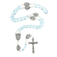 Gorgeous in design, this lovely rosary features aqua-blue Hail Mary beads and rose-shaped Our Father beads. The centerpiece is the Miraculous Medal. The blue shade is especially Marian, and the roses add such a unique, elegant touch. This is truly a wonderful item to give as a gift! Made in Italy.