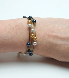 0c767e045a70 Blue and Gold Memory Wire Bracelet - Navy Blue