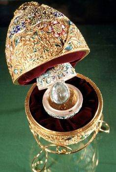 Peter Carl Fabergé. The velvet-lined egg has another egg inside, with another surprise inside that