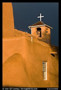 San Francisco de Asisis church under stormy sky. Taos, New Mexico, USA (color) Adobe House, South Of The Border, New Mexican, Land Of Enchantment, Southwest Art, U.s. States, San Francisco, Colorful Pictures, Central America