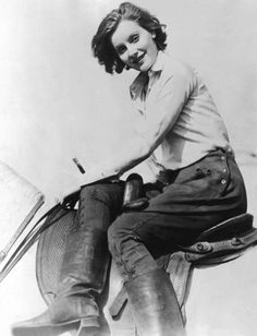 Greta Garbo riding side saddle. note the side snap detail on her breeches and the slouchy, cool boots.