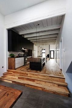 Organic Modern | AT (gorgeous wood flooring and solid hulking wood island with industrial pendants)