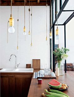 simple + classic + exposed hanging bulbs....All good things are wild and free