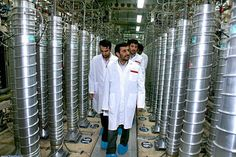In this 2008 photo released by the Iranian President's Office, Iranian President Mahmoud Ahmadinejad visits the Natanz Uranium Enrichment Facility some 200 miles south of Tehran. The International Atomic Energy Agency said Tuesday for the first time that Iran had conducted nuclear-weapons-related experiments as recently as 2009.